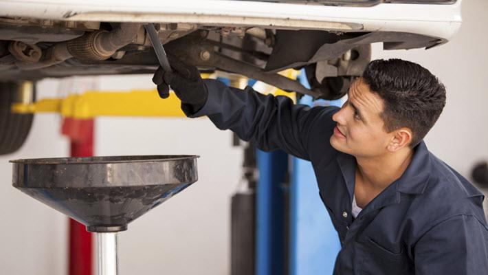 Auto Mechanic Checking Car
