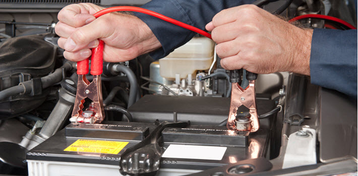 Auto Mechanic Testing Car Battery