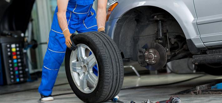 Mechanic Replacing Tire
